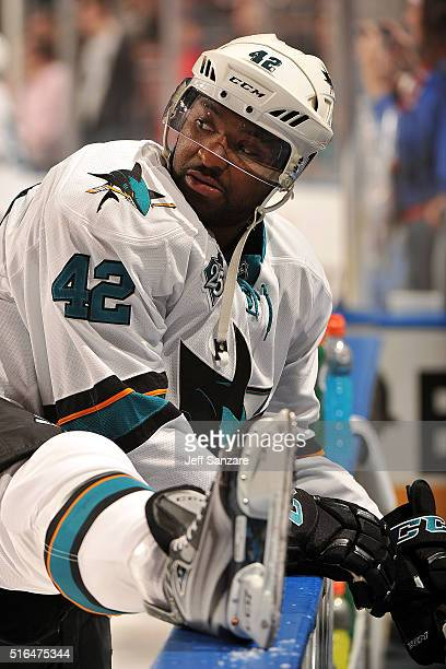 Joel Ward of the San Jose Sharks stretches on the boards prior to the start of the game against the Florida Panthers at the BBT Center on February 18...
