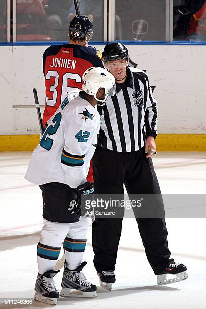 Joel Ward of the San Jose Sharks talks with Linesman Kiel Murchison during a break in the action against the Florida Panthers at the BBT Center on...