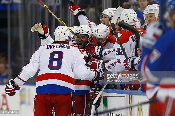 Joel Ward of the Washington Capitals celebrates with Alex Ovechkin after scoring the game winning goal at 1958 against the New York Rangers in Game...