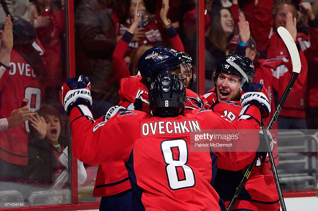 Joel Ward #42 of the Washington Capitals celebrates with his teammates after scoring a goal in the second period against the New York Islanders in Game Seven of the Eastern Conference Quarterfinals during the 2015 NHL Stanley Cup Playoffs at Verizon Center on April 27, 2015 in Washington, DC.