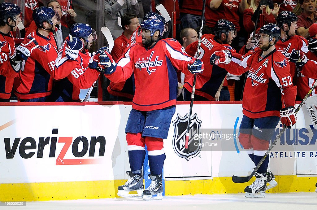 Joel Ward #42 of the Washington Capitals celebrates with teammates after scoring in the second period against the New York Rangers in Game Five of the Eastern Conference Quarterfinals during the 2013 NHL Stanley Cup Playoffs at the Verizon Center on May 10, 2013 in Washington, DC.