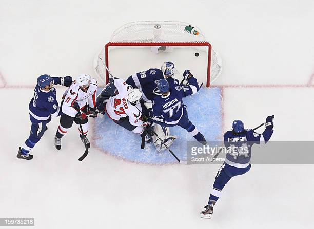 Joel Ward of the Washington Capitals scores a goal past Anders Lindback of the Tampa Bay Lightning and defenseman Victor Hedman at the Tampa Bay...