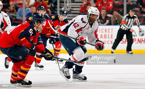 Joel Ward of the Washington Capitals skates for position against Brian Campbell of the Florida Panthers at the BBT Center on December 16 2014 in...