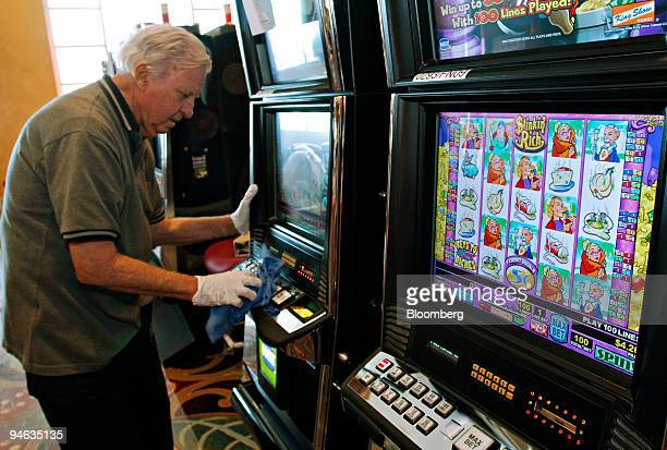 Joel Williams cleans a slot machine in Harrah's Entertainment Inc's Grand Casino in Biloxi Mississippi Tuesday August 8 2006 A year after Hurricane...