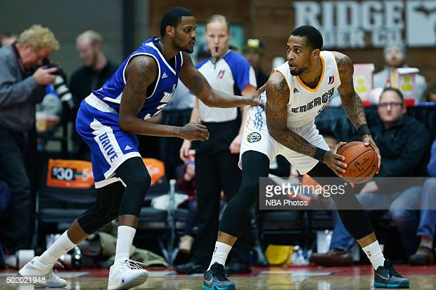 Joel Wright right of the Iowa Energy looks to pass the ball against Devin Ebanks left of the Grand Rapids Drive during the first half of an NBA...