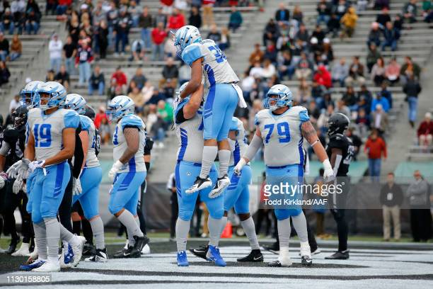 Joel Bouagnon of Salt Lake Stallions celebrates with teammates following a touchdown against the Birmingham Iron during an Alliance of American...