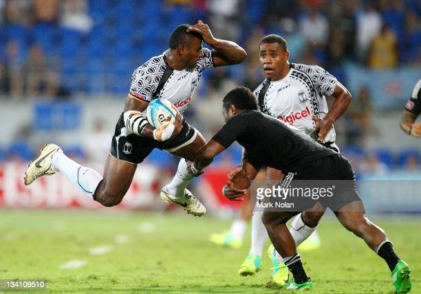 Joeli Lutumailagi of Fiji is tackled during the Cup Final match between New Zealand and Fiji on day two of the Gold Coast Sevens World Series at...