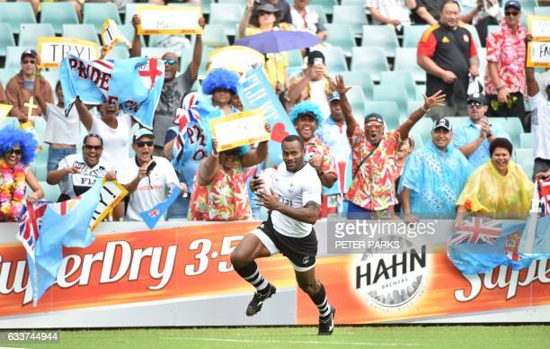Joeli Lutumailagi of Fiji runs past Fiji fans to score a try against Samoa in their pool B match at the Sydney Sevens World Series tournament in...