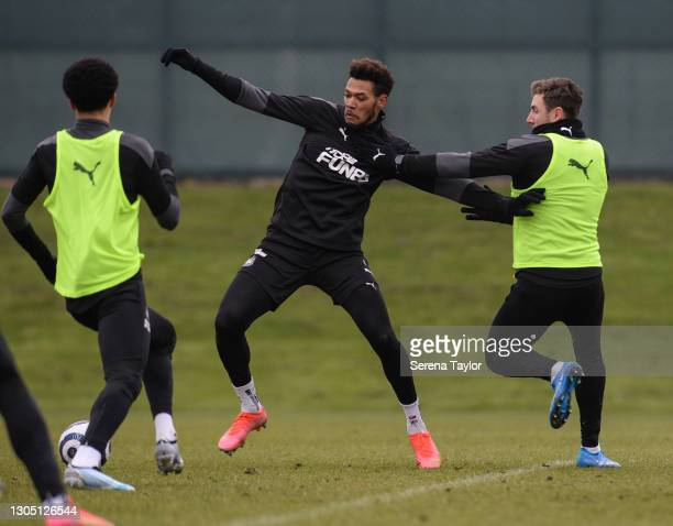 Joelinton and Paul Dummett jostle for the ball during the Newcastle United Training Session at the Newcastle United Training Centre on March 03, 2021...