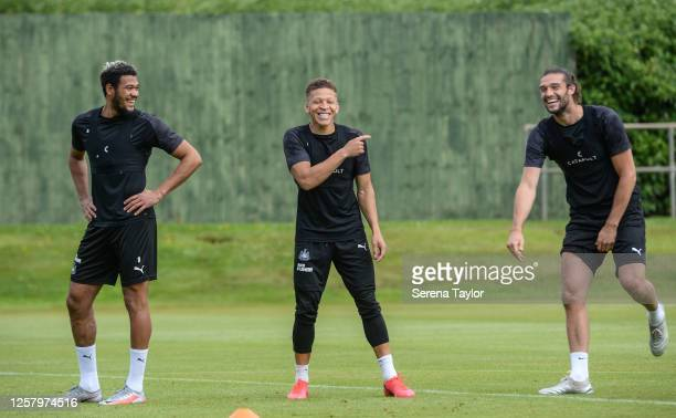 Joelinton Dwight Gayle and Andy Carroll joke during the Newcastle United Training Session at the Newcastle United Training Centre on July 24 2020 in...