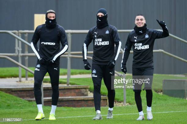 Joelinton Federico Fernandez and Miguel Almiron walk outside during the Newcastle United Training Session at the Newcastle United Training Centre on...