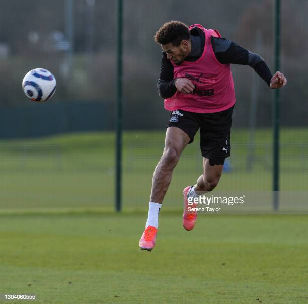 Joelinton heads the ball during the Newcastle United Training session at the Newcastle United Training Centre on February 25, 2021 in Newcastle upon...