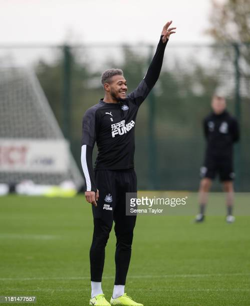 Joelinton holds his arm up smiling during the Newcastle United Training Session at the Newcastle United Training Centre on October 16 2019 in...