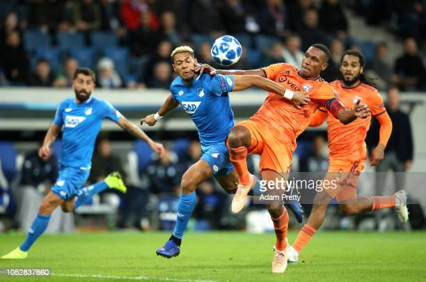 Joelinton of 1899 Hoffenheim challenges for the ball with Marcelo of Olympique Lyonnais during the Group F match of the UEFA Champions League between...