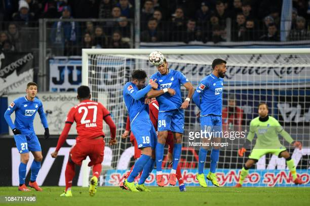 Joelinton of 1899 Hoffenheim defends a free kick from David Alaba of Bayern Munich during the Bundesliga match between TSG 1899 Hoffenheim and FC...