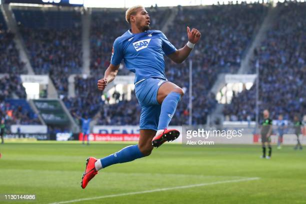 Joelinton of Hoffenheim celebrates his team's first goal during the Bundesliga match between TSG 1899 Hoffenheim and Hannover 96 at PreZeroArena on...