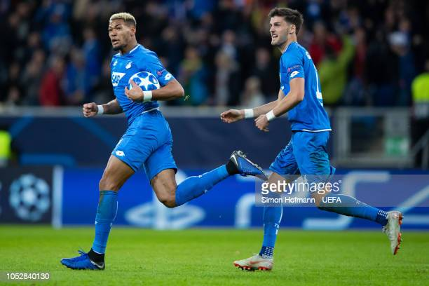 Joelinton of Hoffenheim celebrates his team's third goal with team mate Florian Grillitsch during the UEFA Champions League Group F match between TSG...