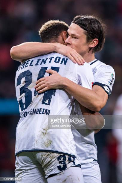 Joelinton of Hoffenheim celebrates with Nico Schulz after scoring his team's fourth goal during the Bundesliga match between Bayer 04 Leverkusen and...