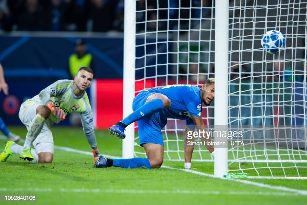 Joelinton of Hoffenheim scores his team's third goal past goalkeeper Anthony Lopes of Lyon during the UEFA Champions League Group F match between TSG...