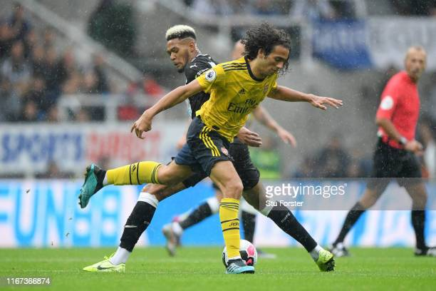 Joelinton of Newcastle United battles for possession with Matteo Guendouzi of Arsenal during the Premier League match between Newcastle United and...
