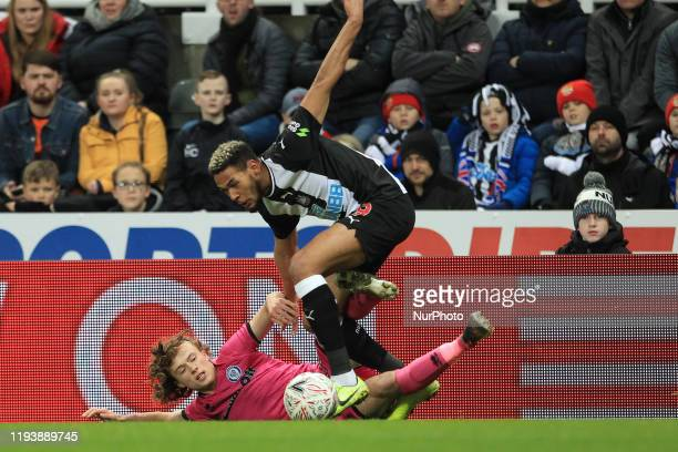 Joelinton of Newcastle United battles with Luke Matheson of Rochdale during the FA Cup match between Newcastle United and Rochdale at St James's Park...