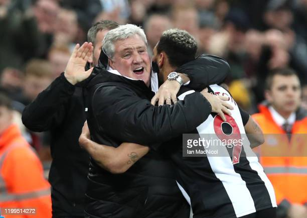 Joelinton of Newcastle United celebrates after escores his team's fourth goal with Manager Steve Bruce during the FA Cup Third Round Replay match...