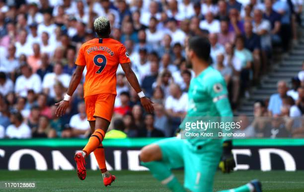 Joelinton of Newcastle United celebrates scoring his teams first goal during the Premier League match between Tottenham Hotspur and Newcastle United...