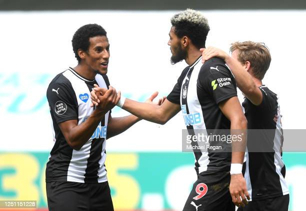 Joelinton of Newcastle United celebrates with Isaac Hayden and Matt Ritchie of Newcastle United after scoring his team's third goal during the...