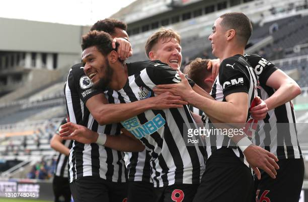 Joelinton of Newcastle United celebrates with team mates after scoring their side's first goal during the Premier League match between Newcastle...