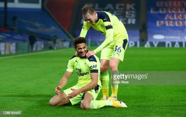 Joelinton of Newcastle United celebrates with teammate Sean Longstaff after scoring their team's second goal during the Premier League match between...
