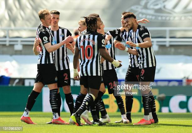 Joelinton of Newcastle United celebrates with teammates after scoring their team's second goal during the Premier League match between Newcastle...