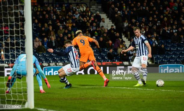 Joelinton of Newcastle United FC back heels the ball to assist Miguel Almirón for his second goal during the FA Cup Fifth Round match between West...