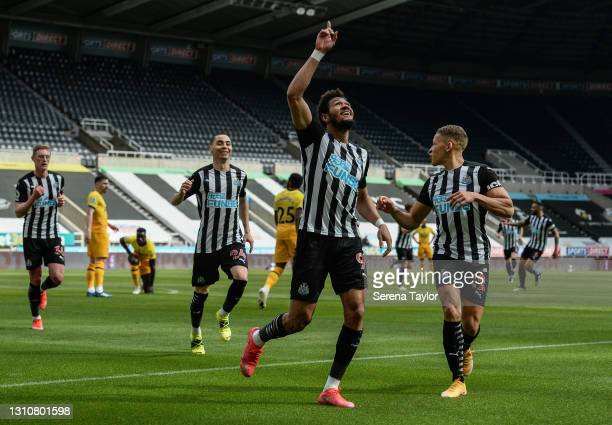 Joelinton of Newcastle United FC celebrates after scoring the opening goal during the Premier League match between Newcastle United and Tottenham...