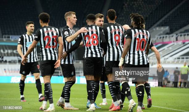 Joelinton of Newcastle United FC celebrates with teammates after he equalizes from the penalty spot scoring Newcastle's second goal during the...