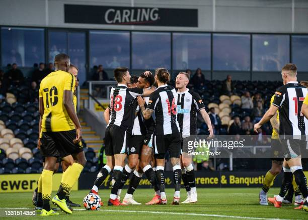 Joelinton of Newcastle United FC celebrates with teammates after scoring the second goal during the Pre Season Friendly between Burton Albion and...