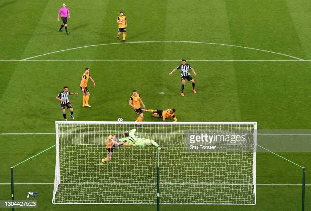 Joelinton of Newcastle United has his shot cleared off the line by Romain Saiss of Wolverhampton Wanderers during the Premier League match between...