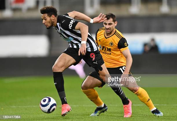 Joelinton of Newcastle United holds off Jonny of Wolverhampton Wanderers during the Premier League match between Newcastle United and Wolverhampton...