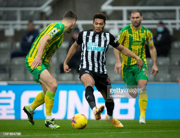 Joelinton of Newcastle United in action with Dara O'Shea and Branislav Ivanovic of West Bromwich Albion during the Premier League match between...