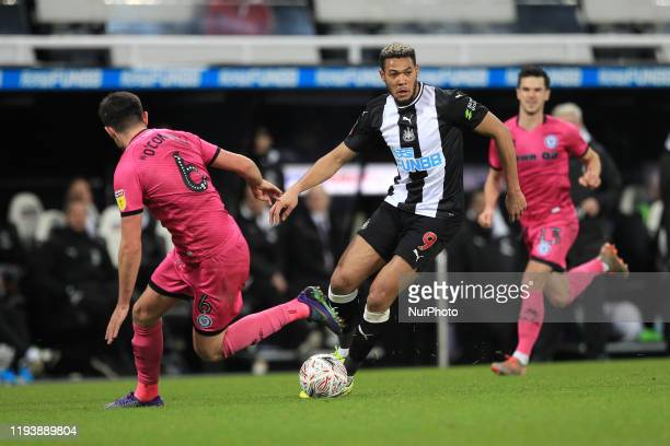 Joelinton of Newcastle United in action with Eoghan O'Connell of Rochdale during the FA Cup match between Newcastle United and Rochdale at St James's...