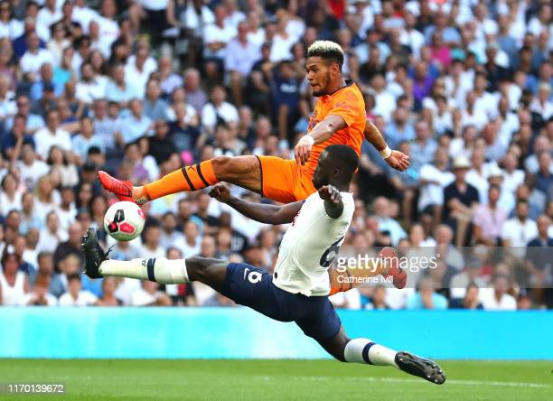 Joelinton of Newcastle United is challenged by Davinson Sanchez of Tottenham Hotspur during the Premier League match between Tottenham Hotspur and...