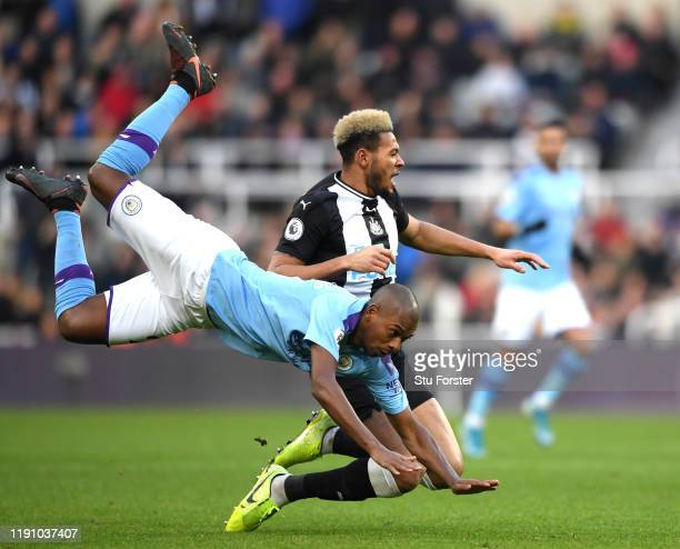 Joelinton of Newcastle United is fouled by Fernandinho of Manchester City during the Premier League match between Newcastle United and Manchester...
