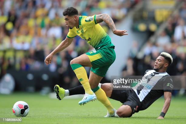 Joelinton of Newcastle United is fouled in a battle with Ben Godfrey of Norwich City during the Premier League match between Norwich City and...