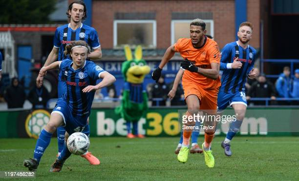 Joelinton of Newcastle United looks to close down Luke Matheson of Rochdale AFC during the FA Cup Third Round match between Rochdale AFC and...