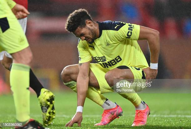 Joelinton of Newcastle United reacts whilst injured during the Premier League match between Manchester United and Newcastle United at Old Trafford on...