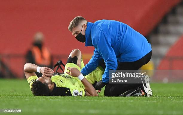 Joelinton of Newcastle United receives medical treatment during the Premier League match between Manchester United and Newcastle United at Old...