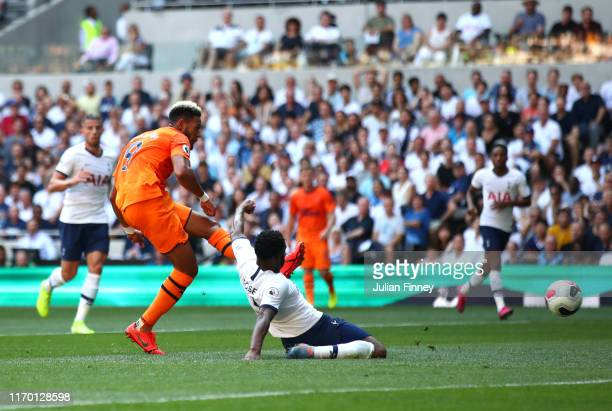 Joelinton of Newcastle United scores his team's first goal during the Premier League match between Tottenham Hotspur and Newcastle United at...
