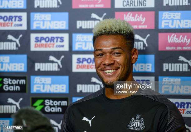 Joelinton of Newcastle United smiles during the Newcastle United Press Conference at the Newcastle United Training Centre on July 24 2019 in...