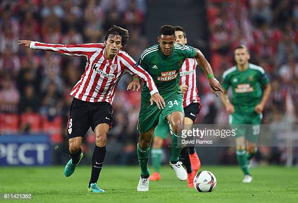 Joelinton of Rapid Vienna holds off the challenge from Ander Iturraspe of Athletic Bilbao during the UEFA Europa League group F match between...