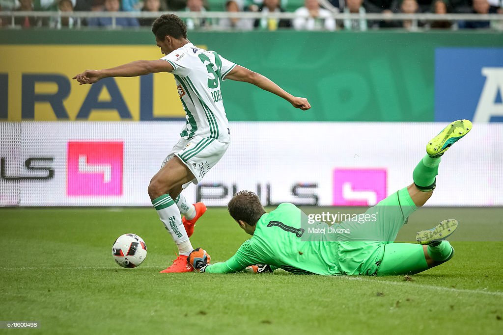 Joelinton (L) of Rapid Vienna scores over Asmir Begovic of Chelsea during an friendly match between SK Rapid Vienna and Chelsea F.C. at Allianz Stadion on July 16, 2016 in Vienna, Austria.