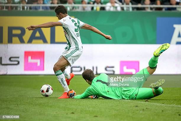 Joelinton of Rapid Vienna scores over Asmir Begovic of Chelsea during an friendly match between SK Rapid Vienna and Chelsea FC at Allianz Stadion on...